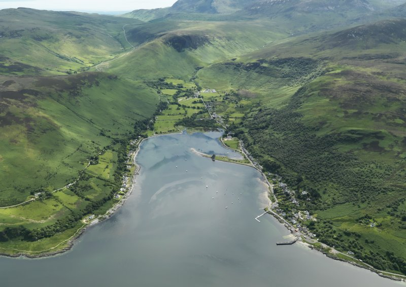 General oblique aerial view centred on Loch Ranza with the village and castle adjacent, taken from the NW.
