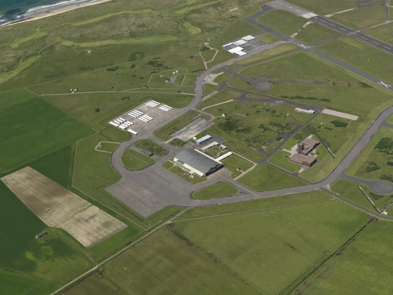 General oblique aerial view centred on the 'Gaydon' aircraft hangar with the USN base adjacent, taken from the SE.