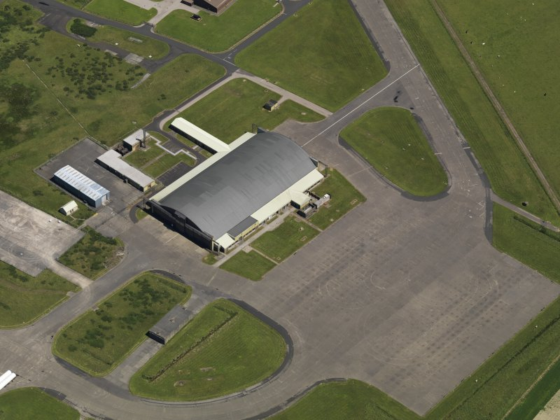 Oblique aerial view centred on the 'Gaydon' aircraft hangar, taken from the SW.
