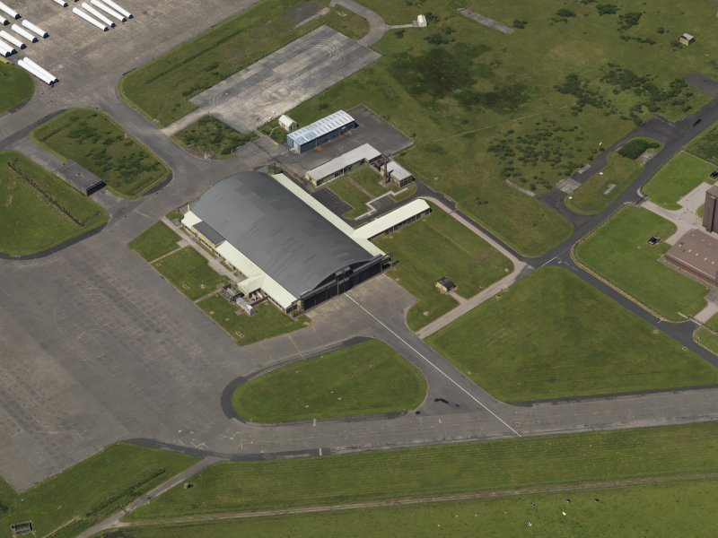 Oblique aerial view centred on the 'Gaydon' aircraft hangar, taken from the SE.