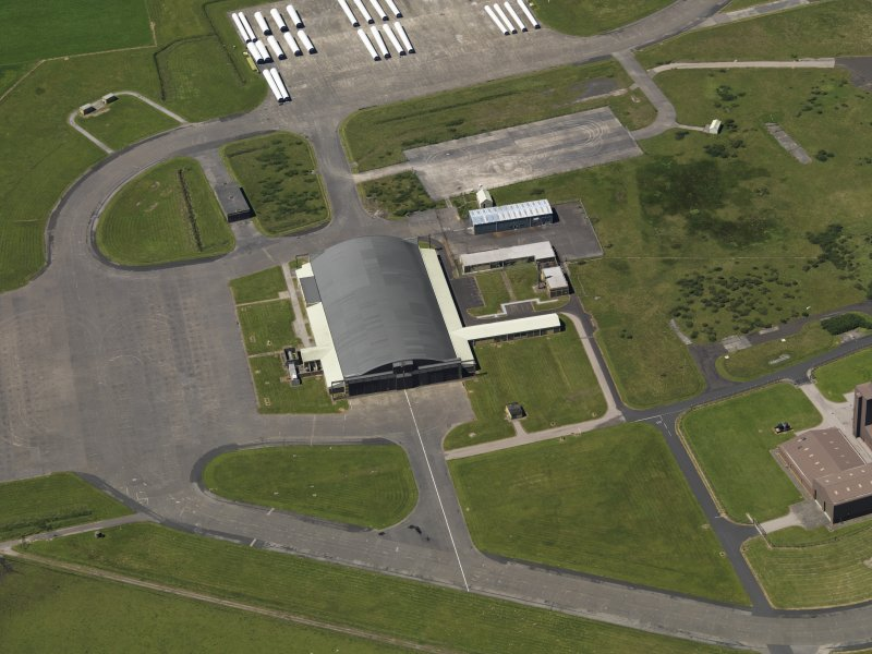 Oblique aerial view centred on the 'Gaydon' aircraft hangar, taken from the E.