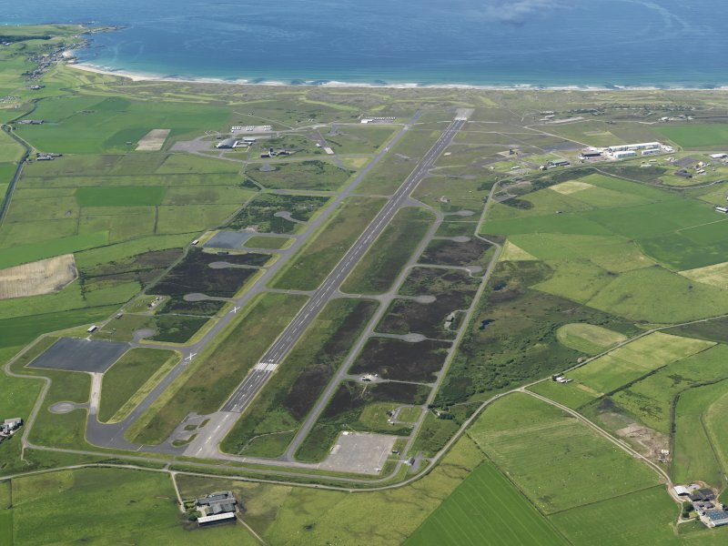 Oblique aerial view of Machrihanish Airfield, taken from the ENE.