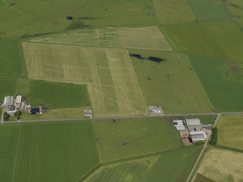Oblique aerial view centred on the remains of the airfield, taken from the S.