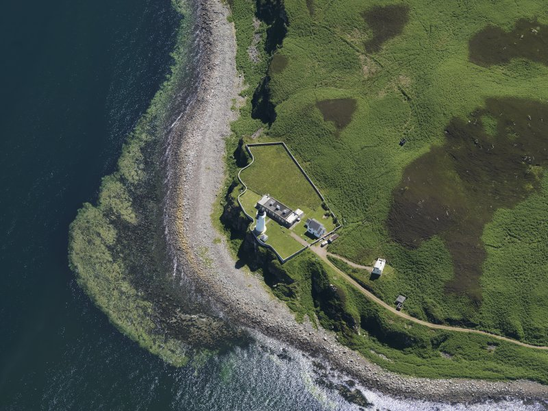 Oblique aerial view centred on the lighthouse with the observation tower adjjacent, taken from the N.