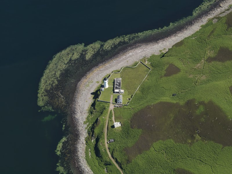 Oblique aerial view centred on the lighthouse with the observation tower adjjacent, taken from the W.