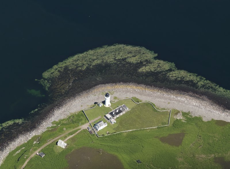 Oblique aerial view centred on the lighthouse with the observation tower adjjacent, taken from the SW.
