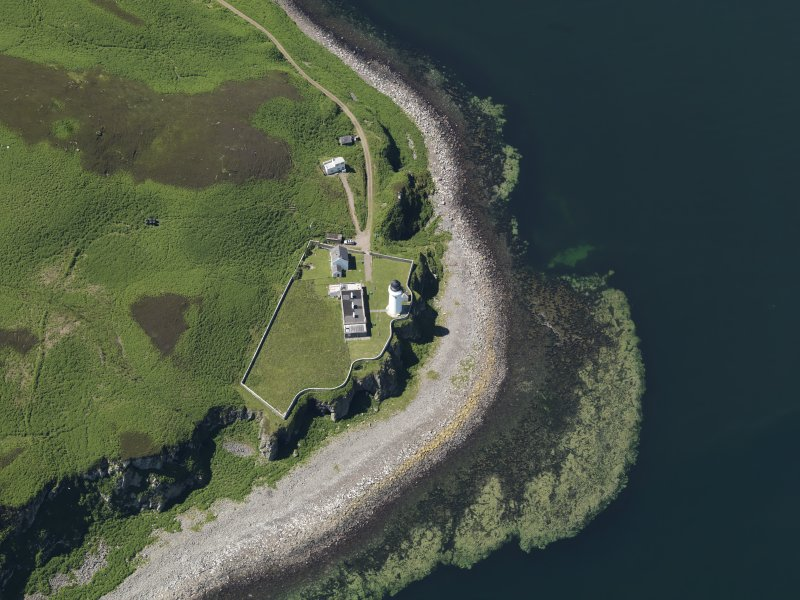 Oblique aerial view centred on the lighthouse with the observation tower adjjacent, taken from the E.