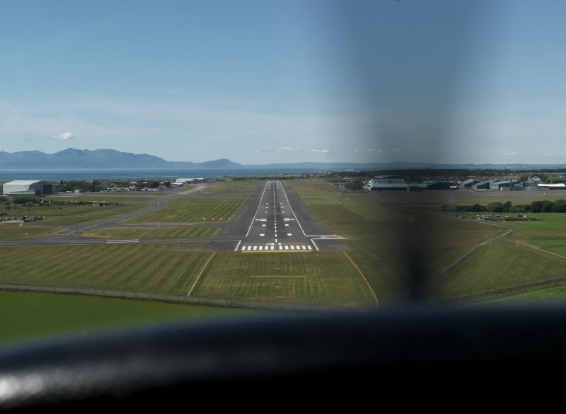 Oblique aerial view centred on the main runway, taken from the SE.