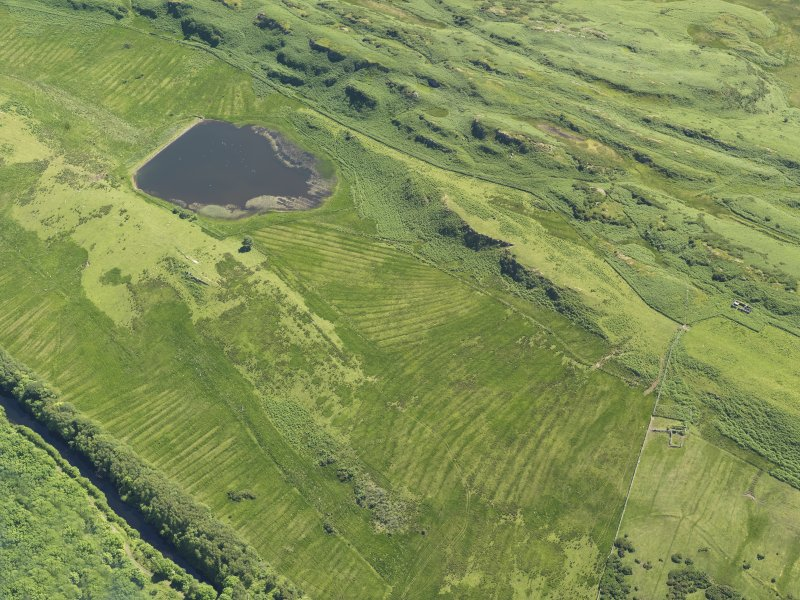 General oblique aerial view centred on the remains of rig and furrow cultivation, taken from the N.