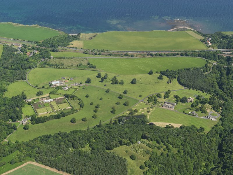 General oblique aerial view of Dunglass, taken from the SSW.