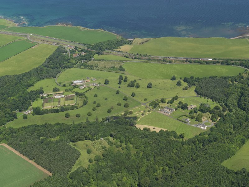 General oblique aerial view of Dunglass, taken from the SW.