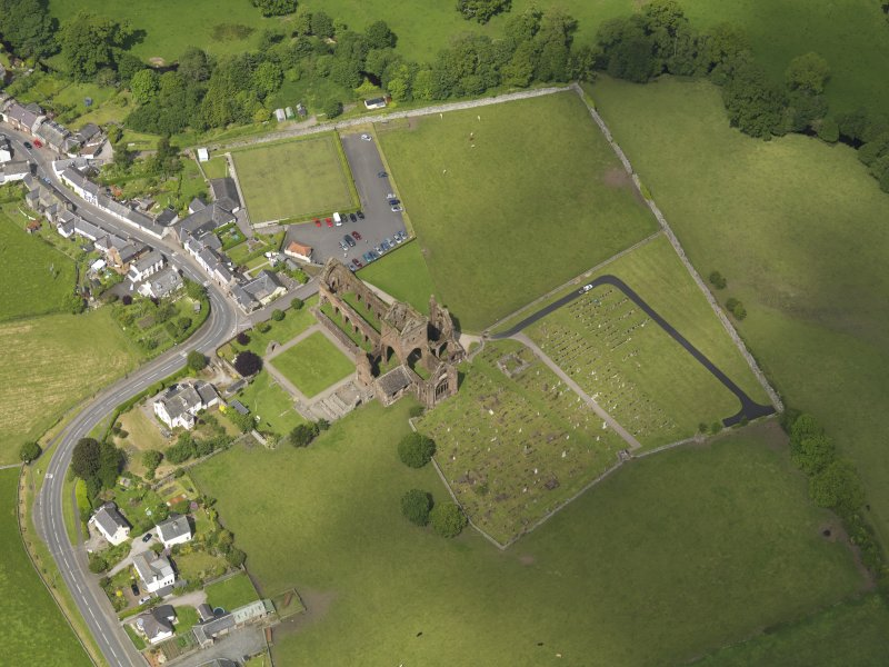 Oblique aerial view of Sweetheart Abbey, taken from the SE.