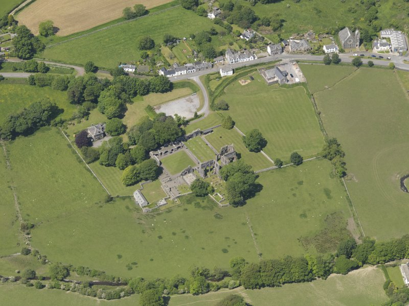 General oblique aerial view of Dundrennan Abbey, taken from the SE.