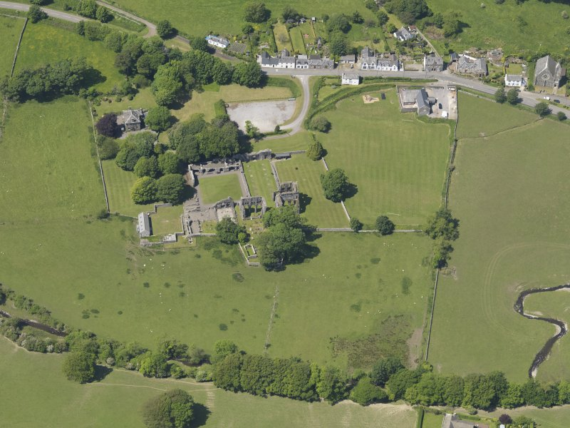 General oblique aerial view of Dundrennan Abbey, taken from the ESE.