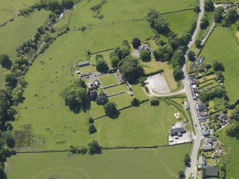 General oblique aerial view of Dundrennan Abbey, taken from the NNE.