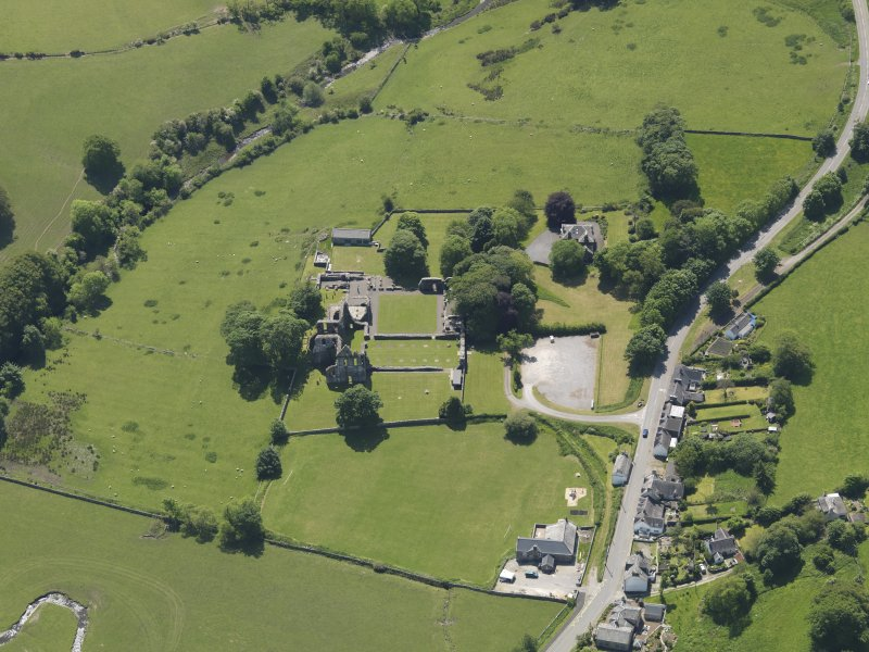 General oblique aerial view of Dundrennan Abbey, taken from the N.