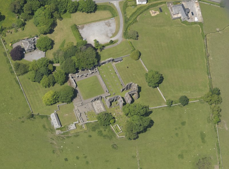 Oblique aerial view of Dundrennan Abbey, taken from the SE.
