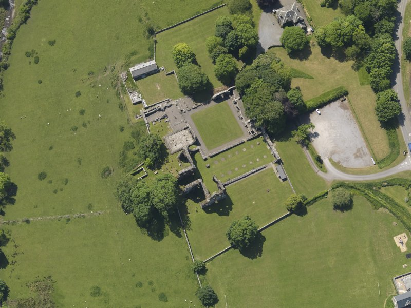 Oblique aerial view of Dundrennan Abbey, taken from the NE.