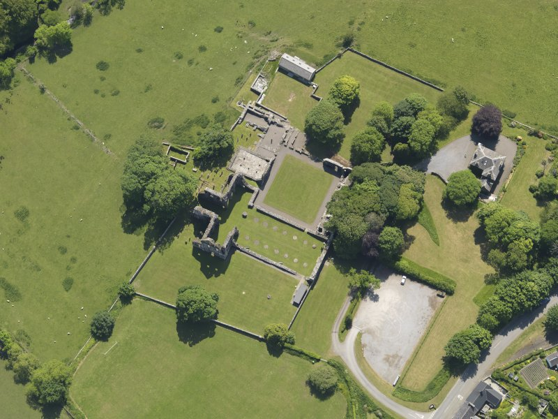 Oblique aerial view of Dundrennan Abbey, taken from the NNW.