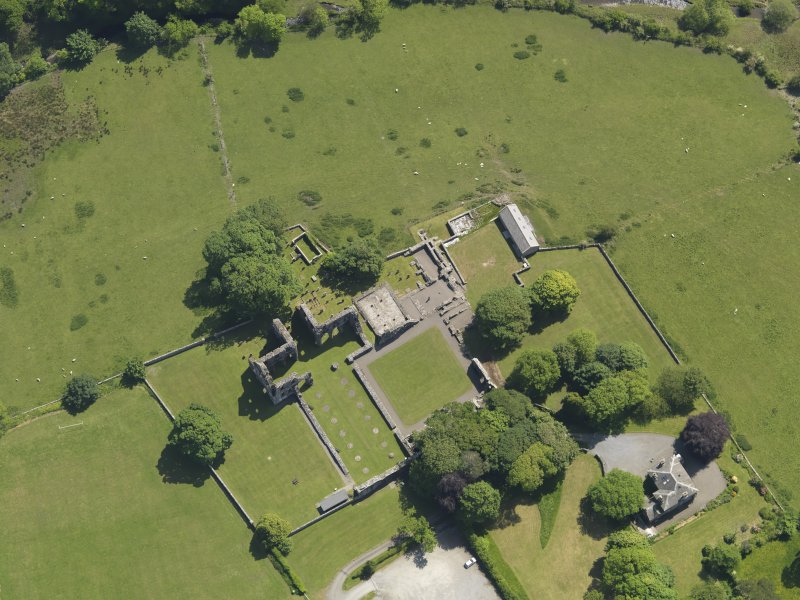 Oblique aerial view of Dundrennan Abbey, taken from the NW.