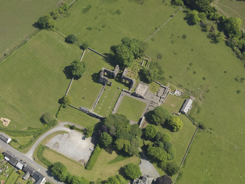 Oblique aerial view of Dundrennan Abbey, taken from the W.
