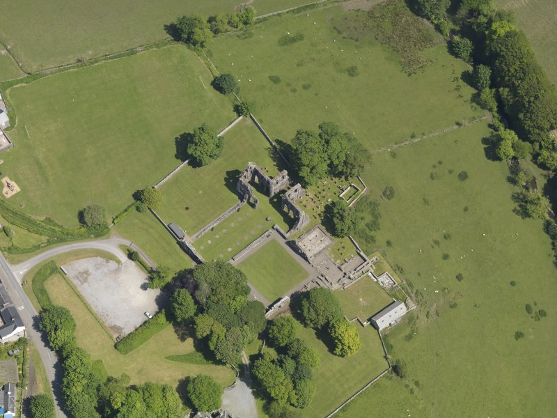 Oblique aerial view of Dundrennan Abbey, taken from the SW.