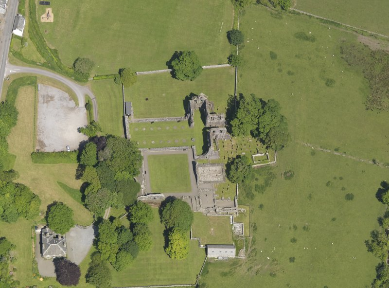 Oblique aerial view of Dundrennan Abbey, taken from the SSW.