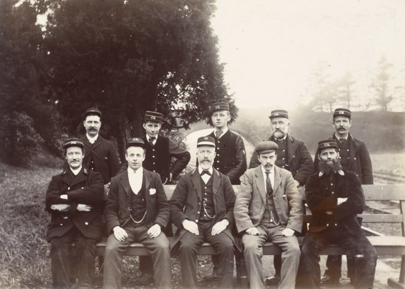 View of a group of ten railway employees, possibly at Stanley Junction.