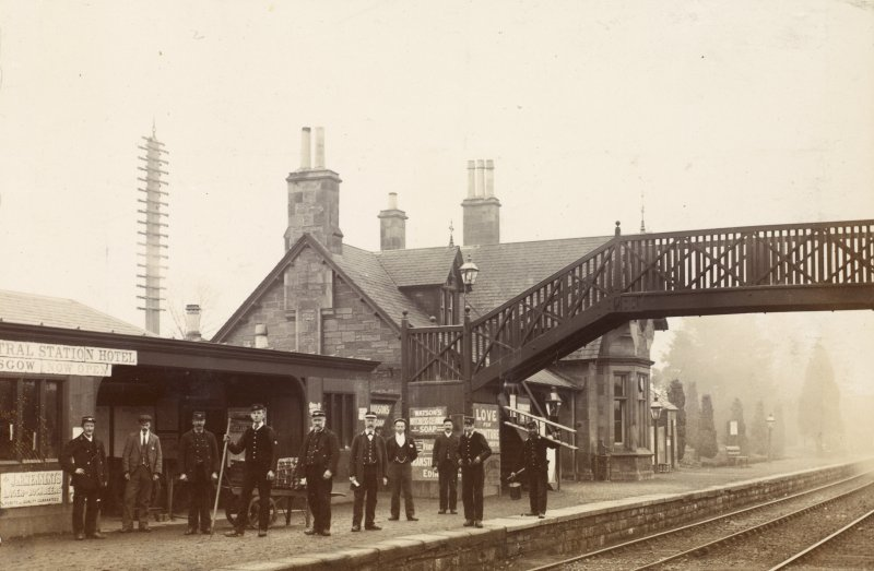 View of group of station workers, likely at Stanley Junction Station, Perthshire.