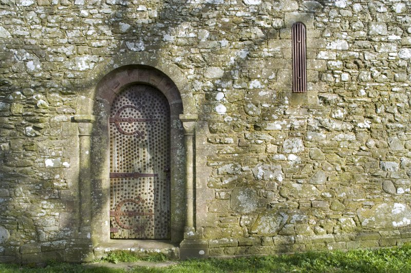 Detail of main doorway and arched window on S elevation of Cruggleton Old Parish Church