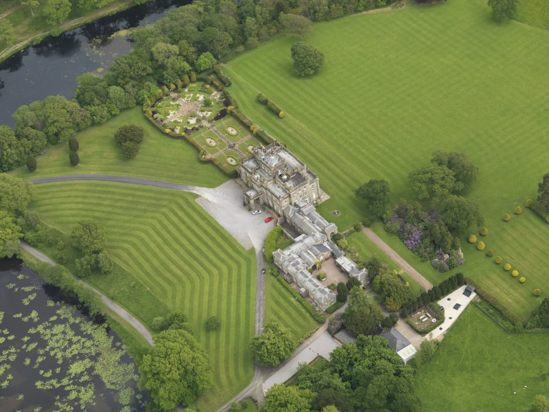 Oblique aerial view of Kinmount House and rose garden, taken from the NW.