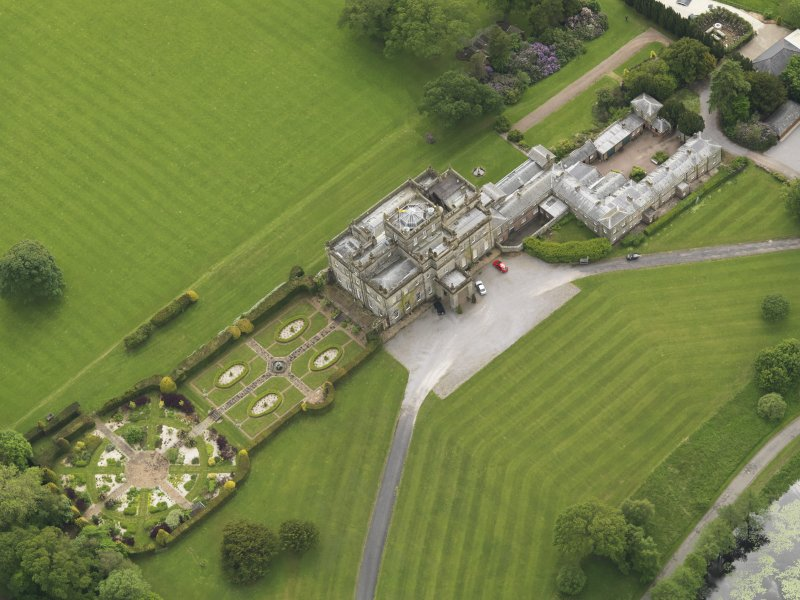 Oblique aerial view of Kinmount House and rose garden, taken from the NE.