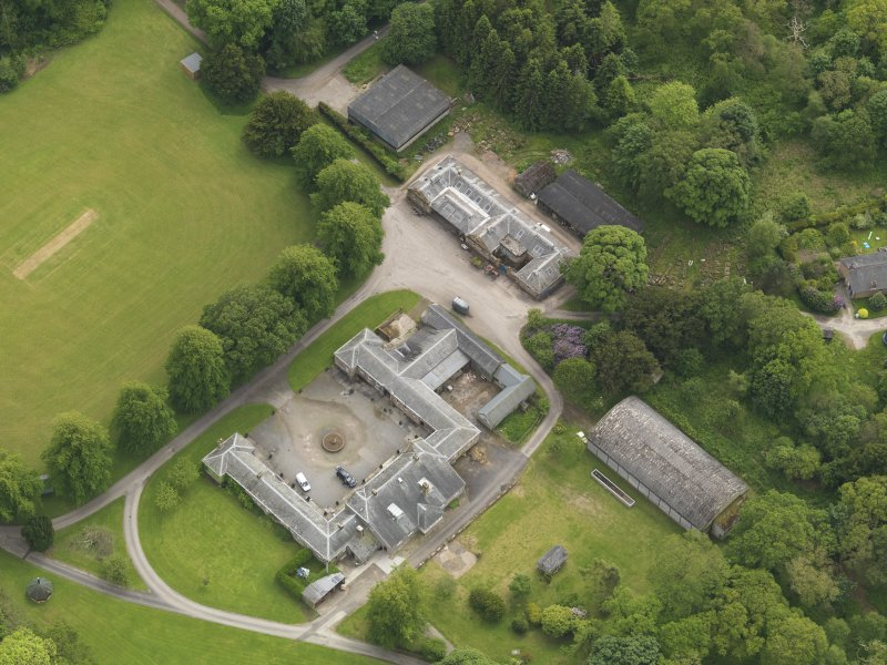 Oblique aerial view of Kinmount House stables, taken from the NNE.