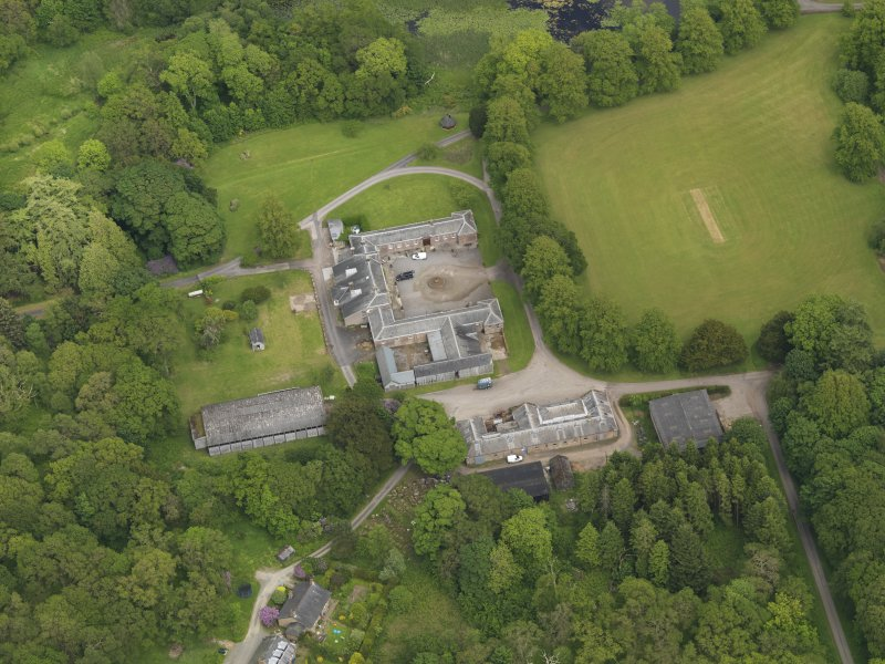 Oblique aerial view of Kinmount House stables, taken from the WSW.