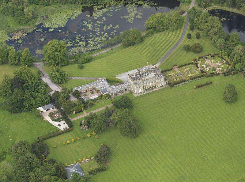 Oblique aerial view of Kinmount House and rose garden, taken from the SSW.