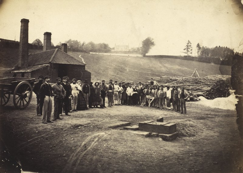 View of the Merricks family and factory workers outside the Roslin Glen Gunpowder Mills. Annotation on page: 'Roslin Mills Cylinders May 1863'.