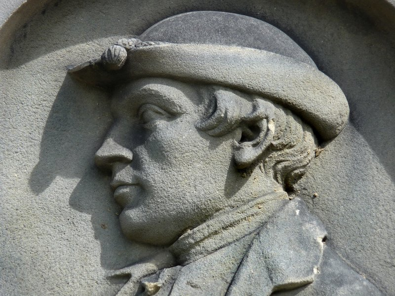 Detail of portrait sculpture on monument in memory of John Runciman (died 1768). Located at Canongate Cemetery.