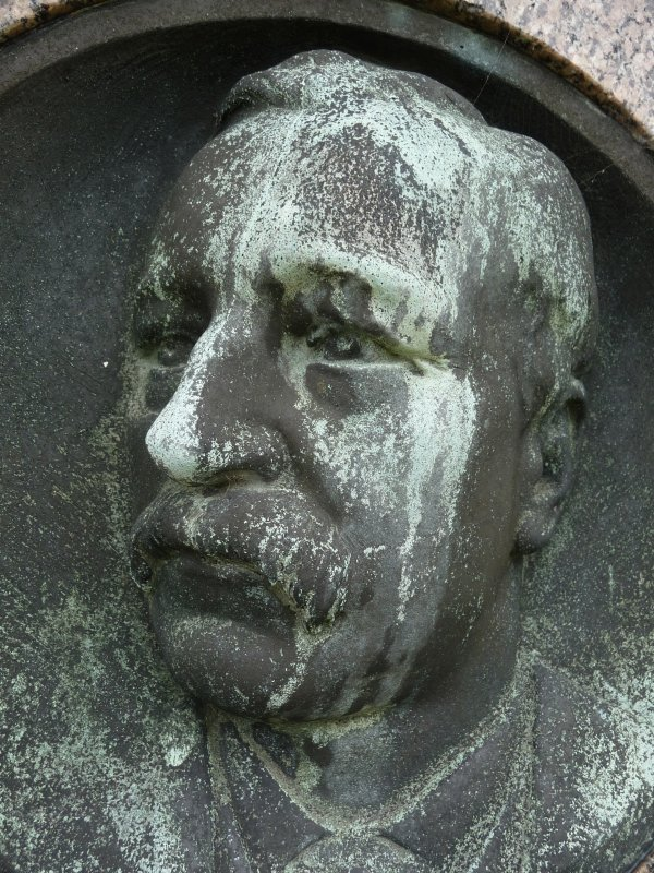 Detail of portrait sculpture on monument in memory of Lord Reginald Macleod. Located at Morningside Cemetery.