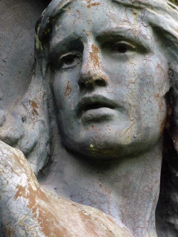 Detail of angel sculpture on monument in memory of Alexander Allan. Located in the Glasgow Necropolis.