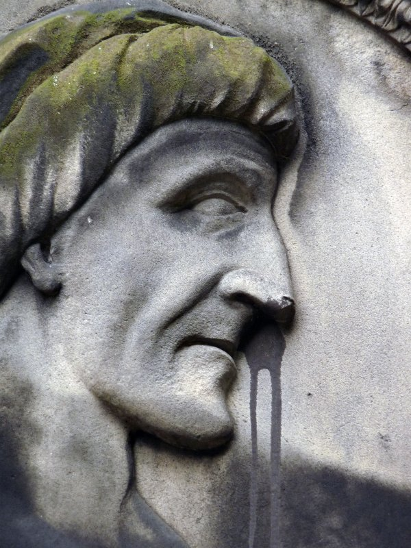 Detail of portrait sculpture on monument in memory of Joanni Carmichael. Located on the north wall of the church building at Greyfriars Cemtery.