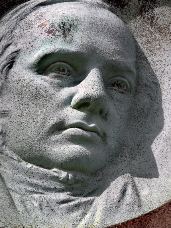 Detail of portrait sculpture on monument in memory of Reverend Alexander MacEwen. Located on top of the hill at the Glasgow Necropolis.