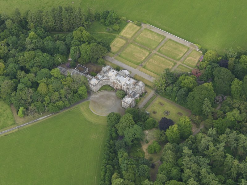 Oblique aerial view of Galloway House and formal garden, taken from the WSW.