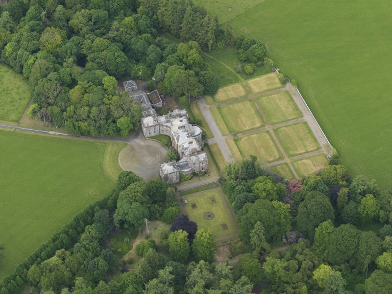 Oblique aerial view of Galloway House and formal garden, taken from the SSW.