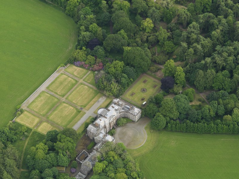 Oblique aerial view of Galloway House and formal garden, taken from the NW.