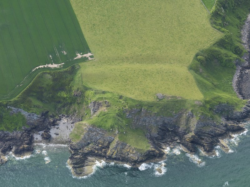 Oblique aerial view of Cruggleton Castle, taken from the SE.