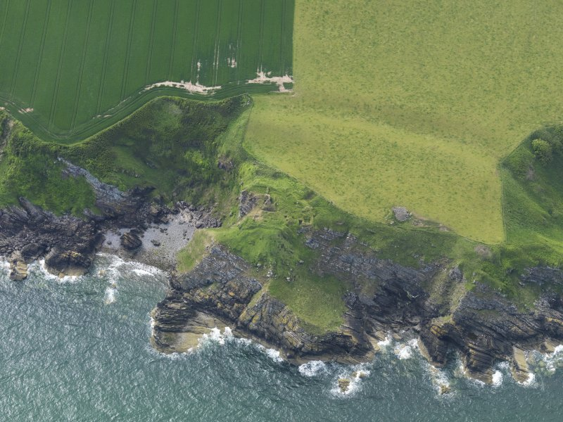 Oblique aerial view of Cruggleton Castle, taken from the ESE.