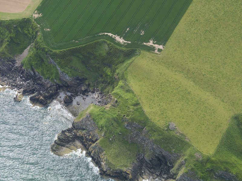 Oblique aerial view of Cruggleton Castle, taken from the E.