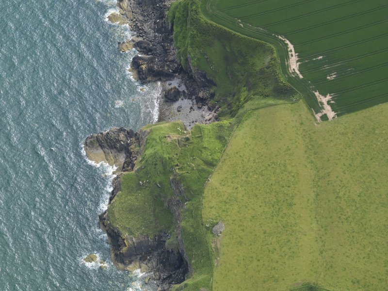 Oblique aerial view of Cruggleton Castle, taken from the NE.