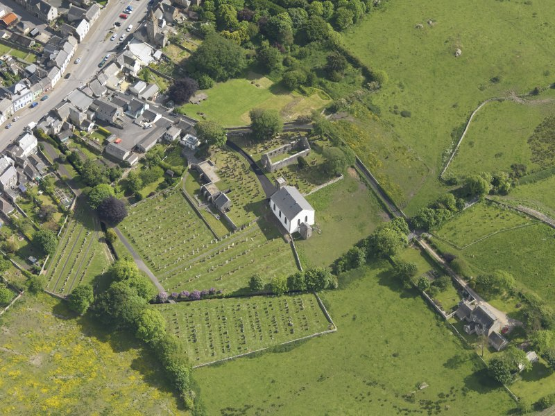 Oblique aerial view of Whithorn Parish Church and priory, taken from the N.