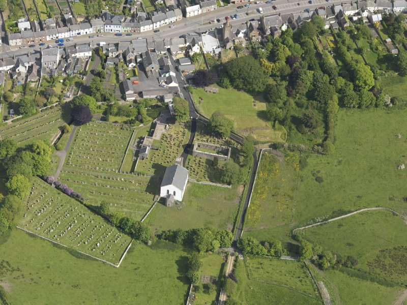 Oblique aerial view of Whithorn Parish Church and priory, taken from the NW.